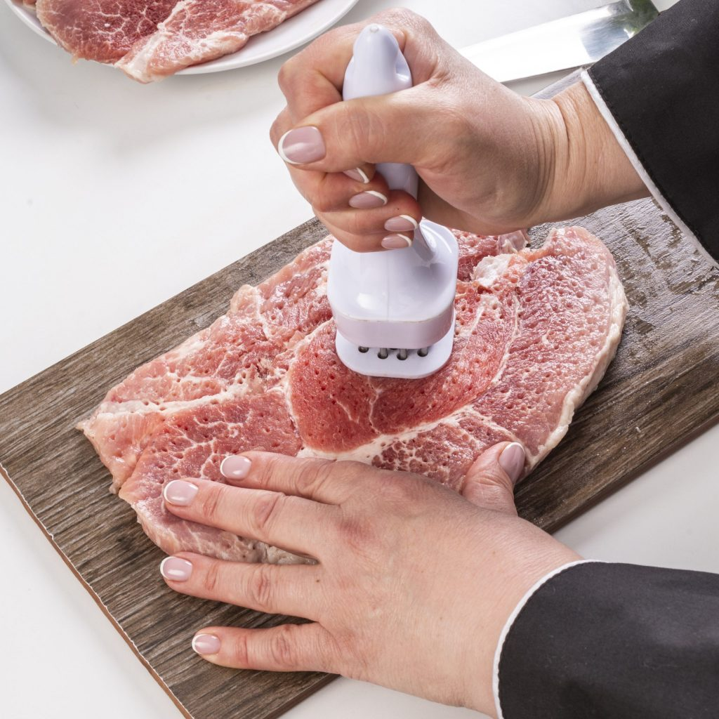 Chef Tenderizing Meat